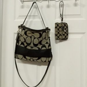 Authentic Coach crossbody and wristlet together.